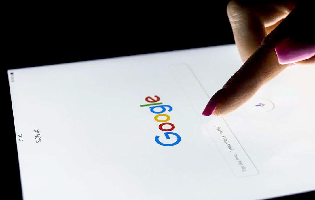 A woman using Google search on a mobile