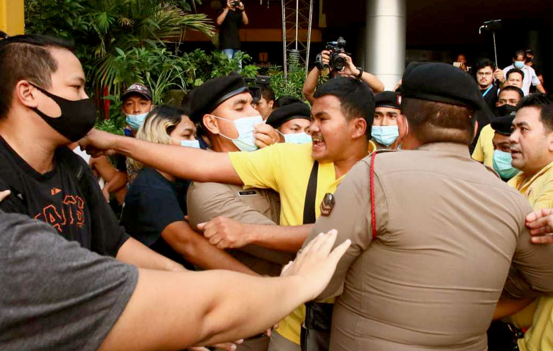 A group of yellow-clad people and student protesters had a brief fight