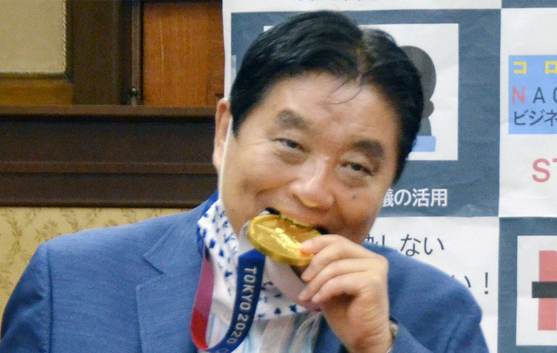 Japanese Mayor Under Fire for Biting Olympian's Gold Medal